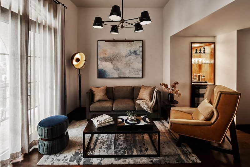 a living room with sofa, chair and coffee table