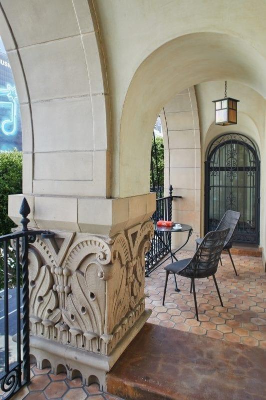 exterior hallway with patio furniture