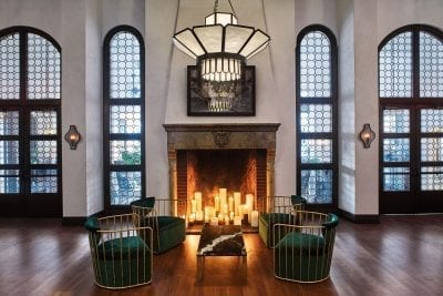 large hall with fireplace, chairs and coffee table