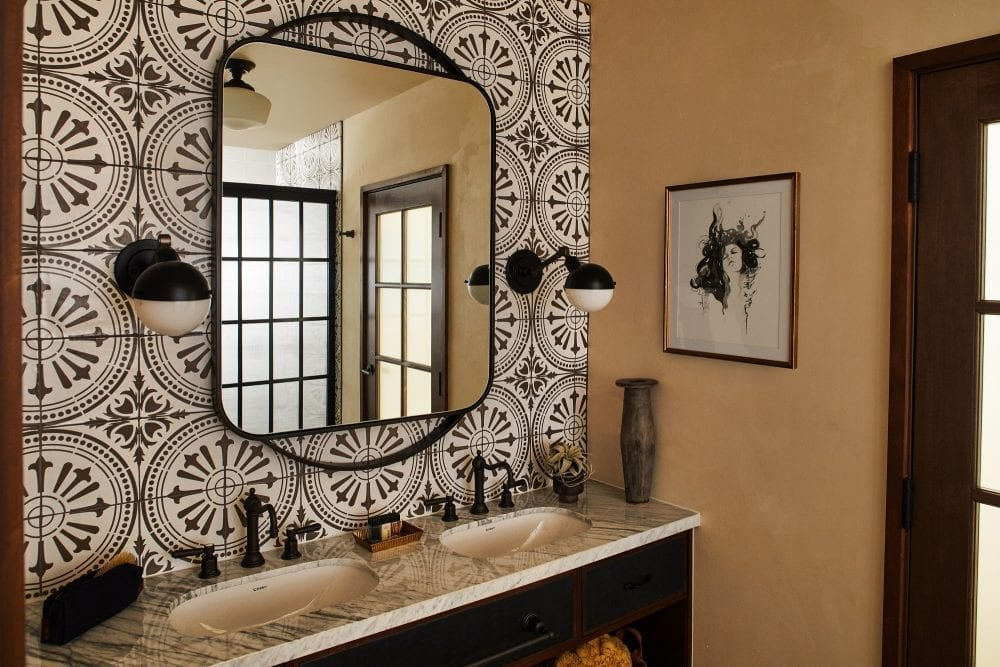 a bathroom with a sink and mirror