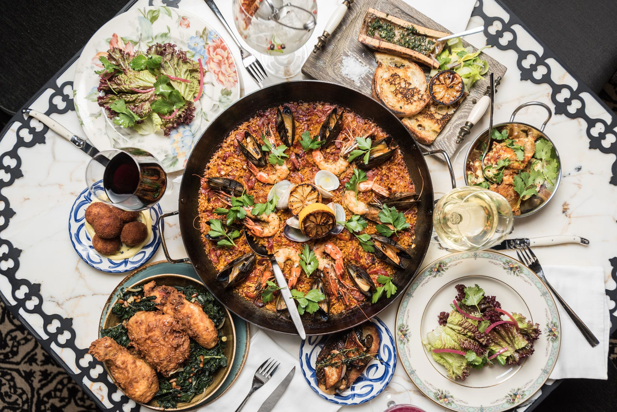 overhead shot of paella and dishes