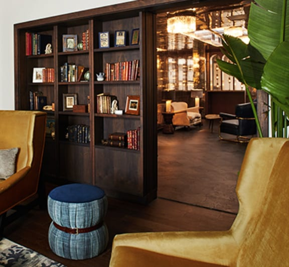 chairs, ottoman, and a bookcase