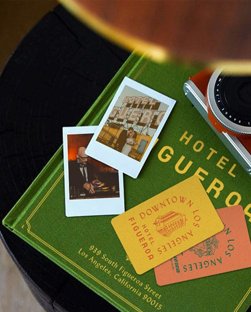 coasters, camera and photos on top of book