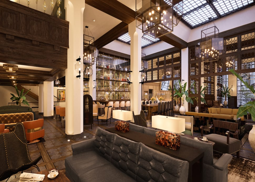 lounge area with leather sofas, chairs, and bar