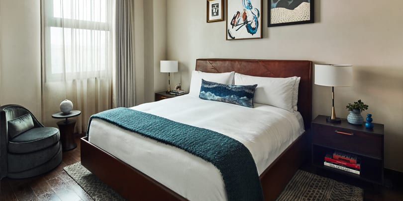 hotel bed, nightstand and chair