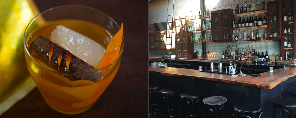 closeup of cocktail and empty bar with stools