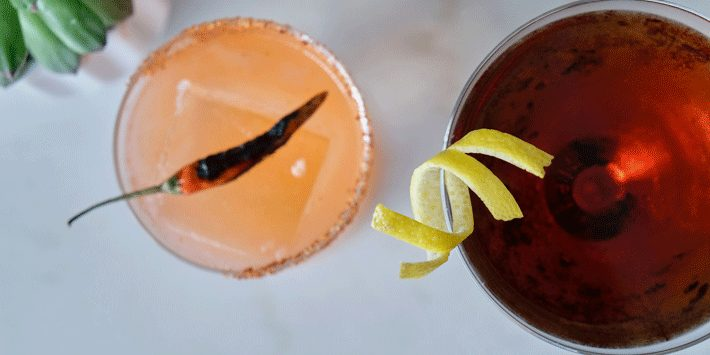 direct overhead view of two cocktail drinks