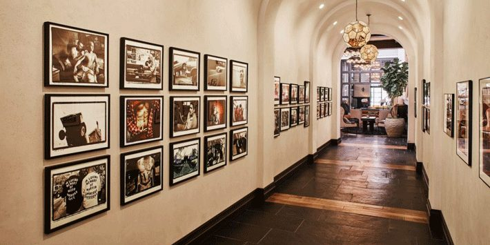 arched hallway with various framed photos