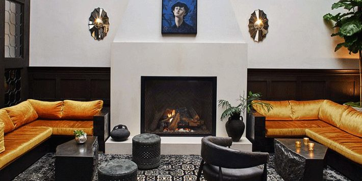 living room with fireplace, sectional sofas, chair, and coffee tables