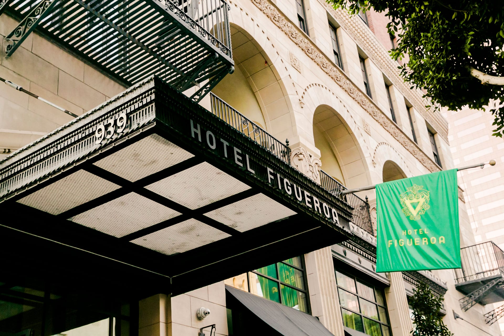 awning at entrance of hotel figueroa with green flag